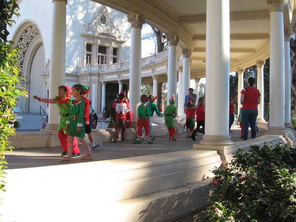 Energetic elves run about the colonnade of the Spreckels Organ Pavilion during 2017 Christmas on the Prado in Balboa Park!