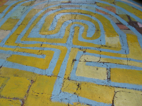 I learned the yellow in this labyrinth was painted a couple weeks ago by an artist who works in Studio 10. Now the magical design really stands out. You'll find it in front of Studio 13. Many curious kids (and some adults) like to journey down this curving path!