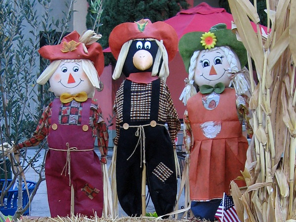 That scarecrow in the middle looks like a crow in disguise!