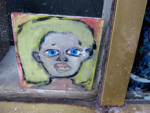 Someone is wide awake and bright-eyed behind this shop window.
