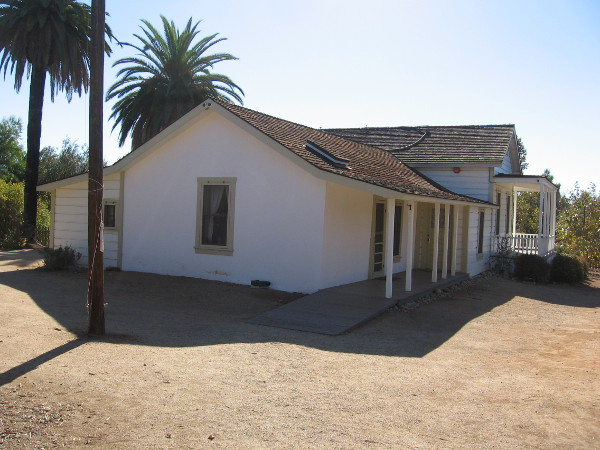 A simple adobe house, typical of the early American era, shortly after California had achieved statehood.