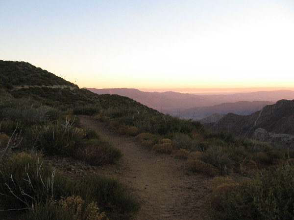 Looking roughly northeast as color creeps over the desert below.