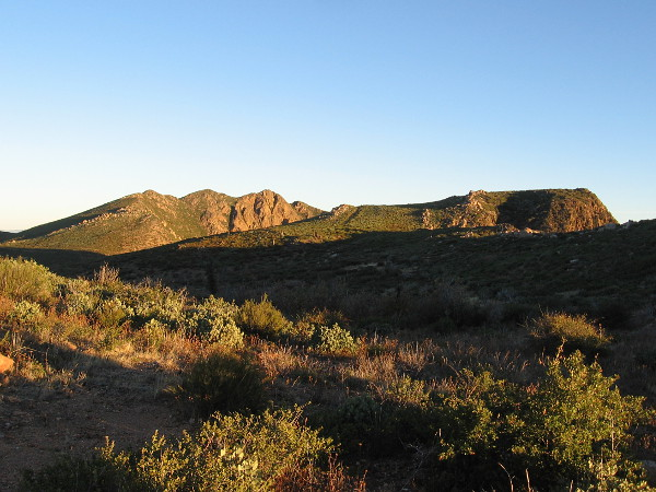 Garnet Peak, on the left, rises into the morning sunlight. A short trail leads to its summit from the Pacific Crest Trail.