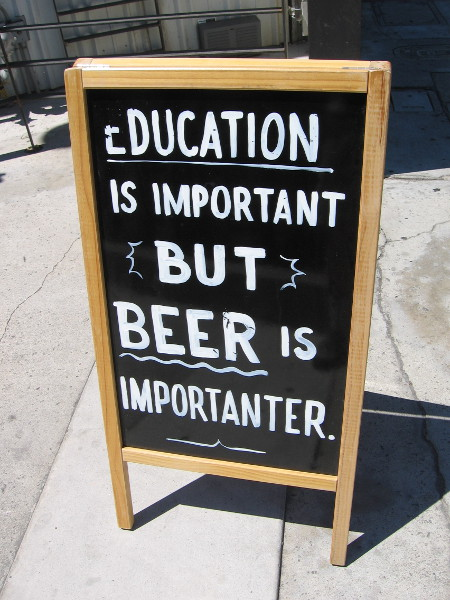 Education is important but beer is importanter, according to a sign in front of Coin Haus in La Mesa.