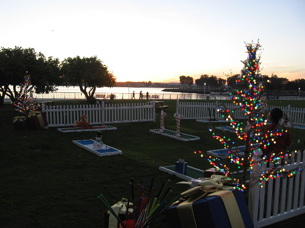 It's almost sunset on Thanksgiving. Some cheerful Christmas trees are lit.
