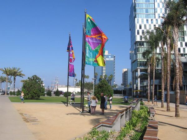 Three colorful windglyphs created by San Diego artist Lisa Schirmer fly above Lane Field Park.