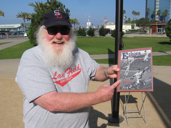 Local baseball expert Bill Swank shows his book Echoes from Lane Field, which recounts the early years of San Diego baseball and the Padres.