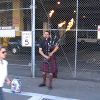 Street musician plays flamethrower bagpipes!