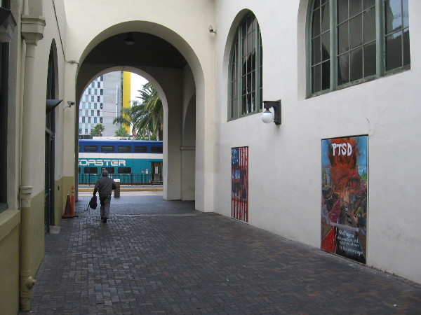Someone walks through the breezeway between MCASD and Santa Fe Depot in downtown San Diego.