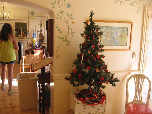 A beautiful small Christmas tree inside the House of Sweden cottage.