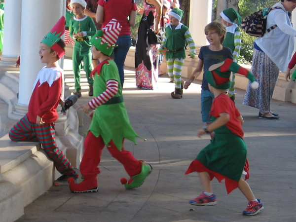 Numerous elves show up at the Spreckels Organ Pavilion during 2017 Christmas on the Prado.