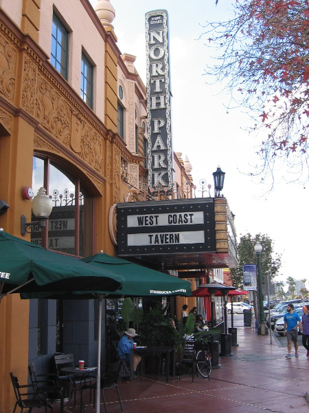 Diners sit outside the West Coast Tavern in North Park. The building is a former movie theater.