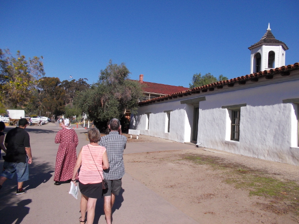 Visitors on a tour in Old Town San Diego State Historic Park learn about our city's origin and early years.
