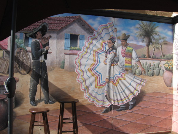 Colorful, festive Mexican-themed artwork adorns a shop in Old Town.