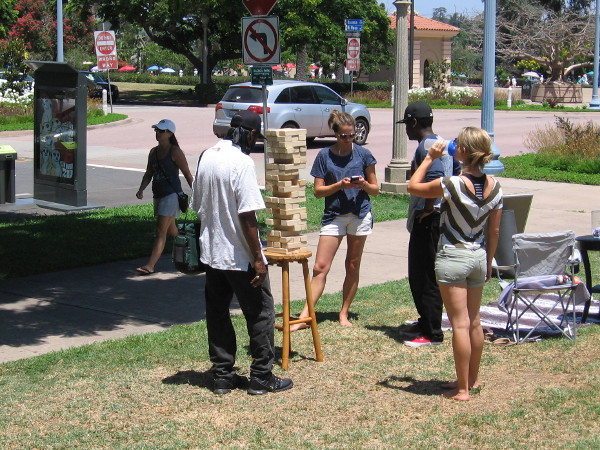 People play Jenga on the grass near Sefton Plaza in Balboa Park.