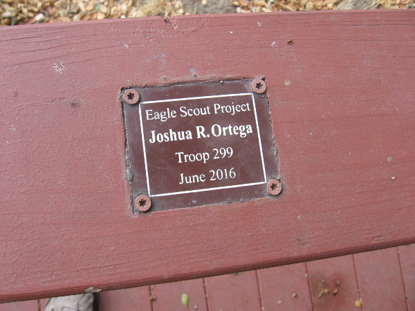Plaque on the bridge reads Eagle Scout Project - Joshua R. Ortega - Troop 299 - June 2016.