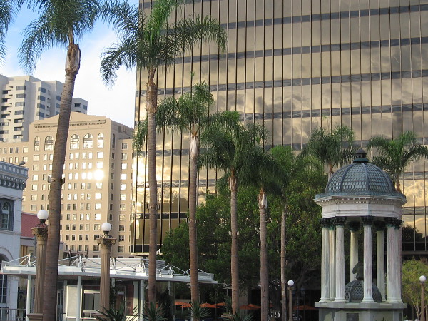The classic Broadway Fountain and nearby downtown buildings. Photo taken one morning in Horton Plaza Park.
