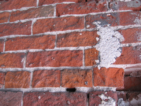 Old bricks of a Gaslamp building have been patched.