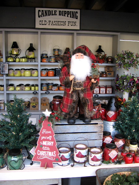 Santa wishes everyone a Merry little Christmas inside Toby's Candle and Soap Shop.