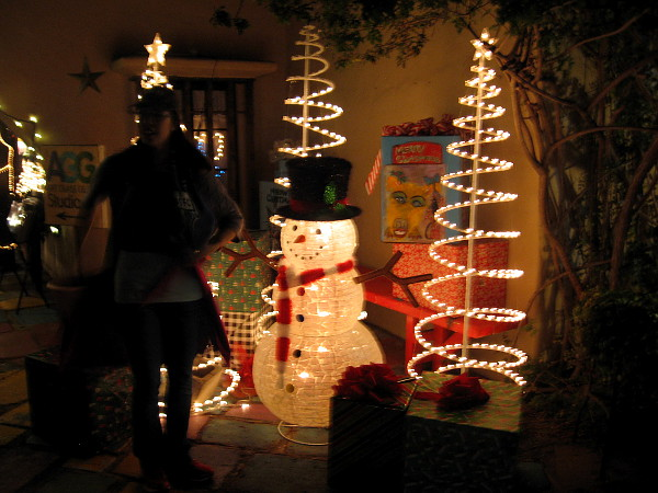 A fun, illuminated snowman in Spanish Village. Festive lights dazzle at 2017 December Nights.
