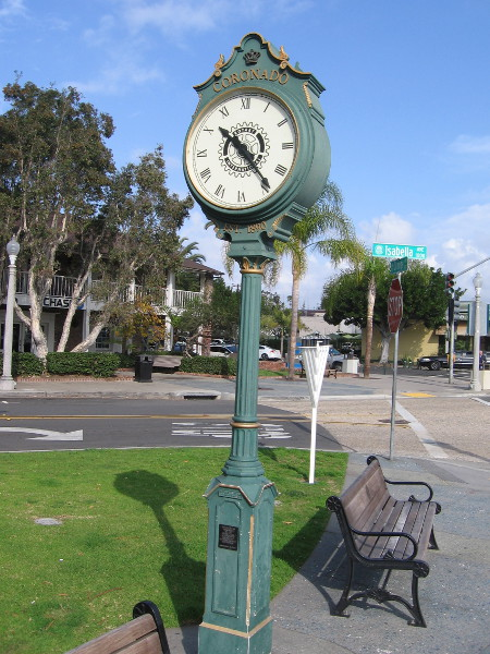 A handsome old clock and bench await passersby in Coronado Rotary Park.
