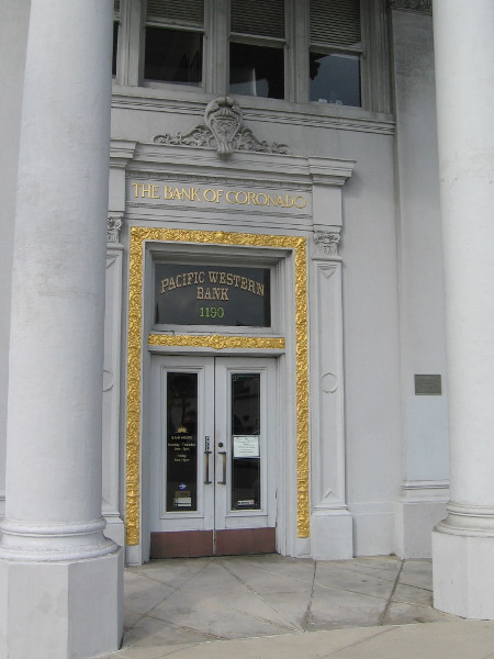 Fancy gold ornamentation around front entrance of the Bank of Coronado, an historical landmark.