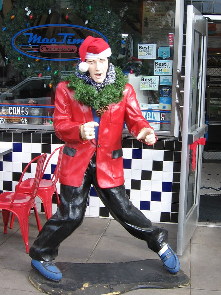 Santa Elvis at MooTime Creamery is sporting a wreath around his neck.