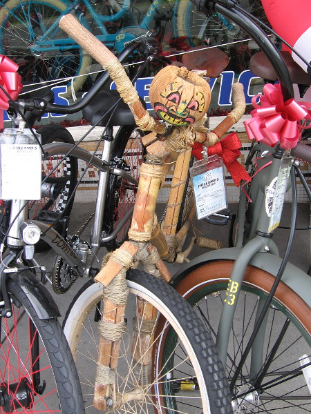 A fun tiki-style bamboo bike in front of Holland's Bicycles.