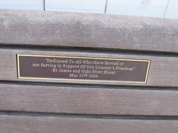 Plaque on bench reads Dedicated to All Who Have Served or Are Serving in Support of Our Country's Freedom.