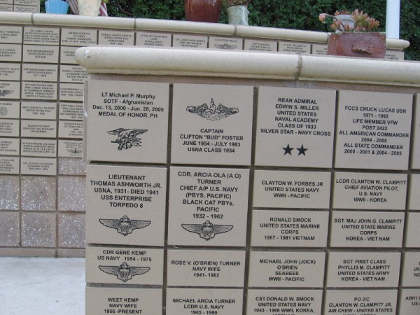 Tiles on the outdoor Memorial Wall remember those who have served in the United States Armed Forces.