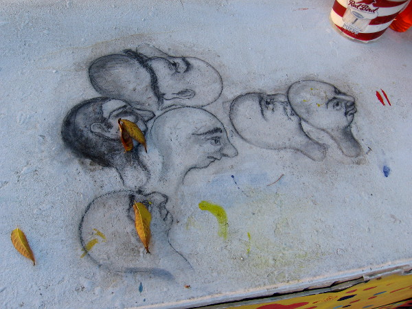 Many faces among leaves. Art discovered on Spanish Village's outdoor Studio 10 work table.