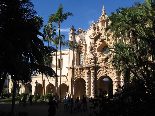 People are entertained on El Prado one beautiful winter's day in Balboa Park. The facade of the Casa del Prado makes a fantastic backdrop.