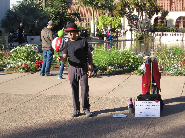 I often see this silent, very funny busker in Seaport Village. He was performing his magic today in Balboa Park.