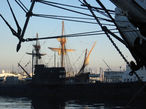 Masts and furled sails of the Spanish galleon replica San Salvador turn golden a few minutes after sunrise.
