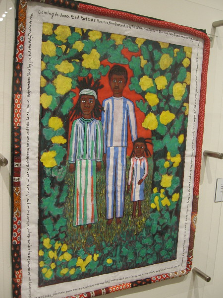Coming to Jones Road Part II #5, Precious, Barn Door and Baby Freedom. Faith Ringgold, acrylic on canvas with fabric border, 2010.