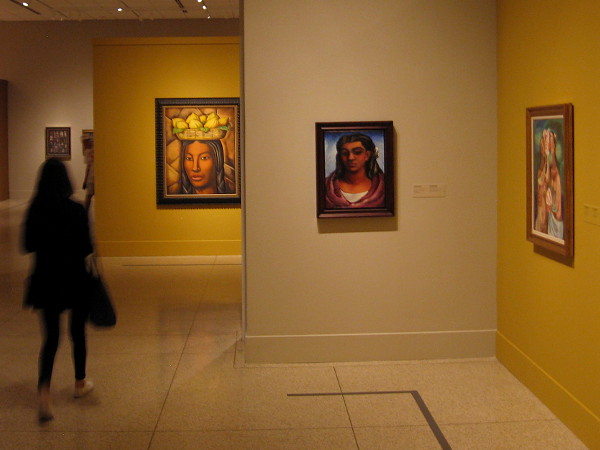 A visitor to the San Diego Museum of Art explores Modern Masters from Latin America, from the Perez Simon Collection.