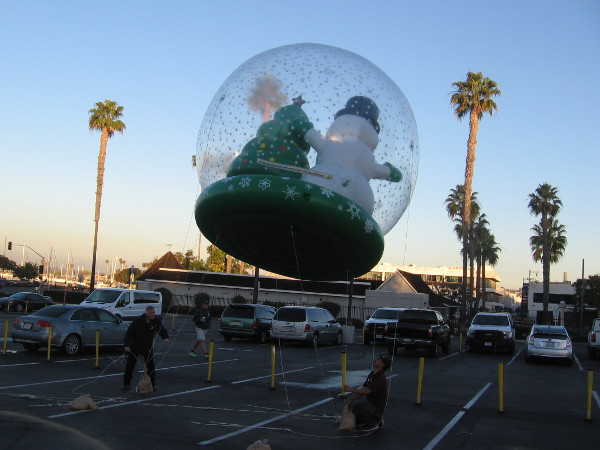 Back where the Holiday Bowl Parade balloons were being inflated, a snow globe containing Frosty was rising like magic into the blue San Diego sky.