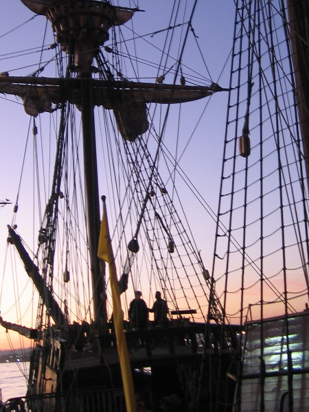Visitors to the Maritime Museum of San Diego pause on the beautiful ship San Salvador as evening slowly turns to night.