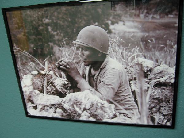 Navajo Code Talker PFC Carl Gorman mans his observation post overlooking Garapan Saipan, 1944.
