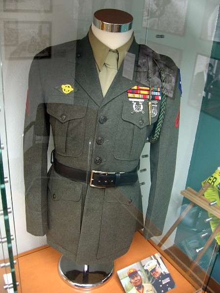 This enlisted man's uniform jacket, shirt and tie belonged to Samuel Tsosie Sr. The Guadalcanal patch was worn on discharge uniforms by all Navajo Code Talkers.