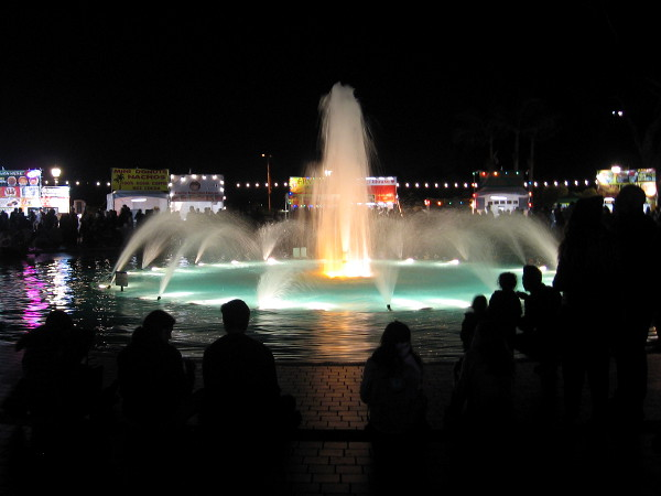 The Bea Evenson fountain in the Plaza de Balboa is brightly lit for December Nights.