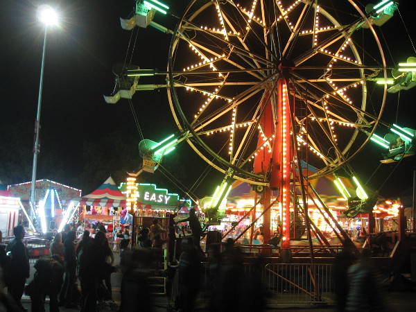 The fun zone in the Palisades area of Balboa Park features brightly lit rides for the kids.