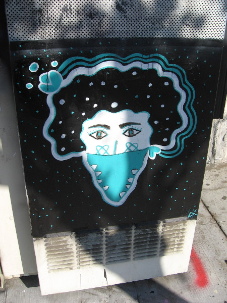 Street art spotted during a walk along North Park Way. This masked face looks a bit like a cosmic ice cream cone.