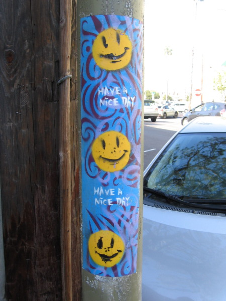 Three somewhat sickly smileys on a Have a Nice Day sticker.