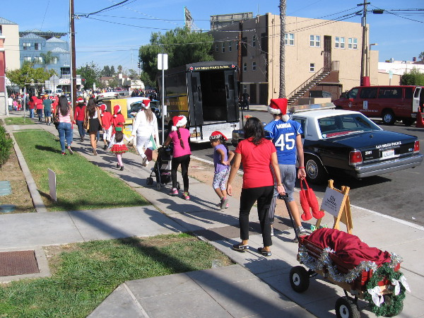Kids head toward the parade route, which begins along University Avenue in San Diego's North Park neighborhood.