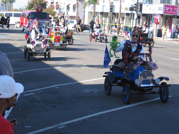 Here come those fun little parade vehicles the Shriners always drive.