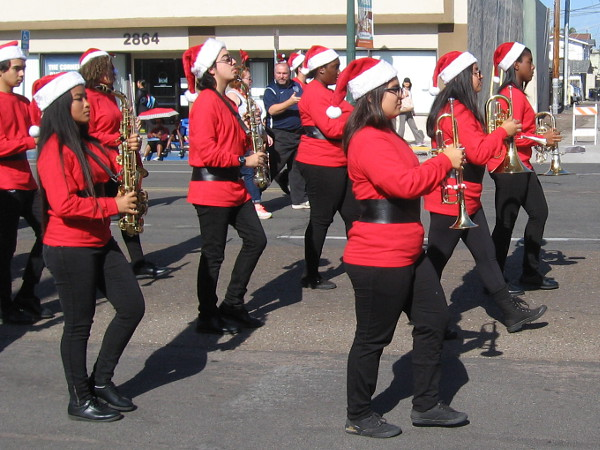 Marching cheerfully down University wearing Santa hats. Many familiar holiday tunes were performed during the parade.