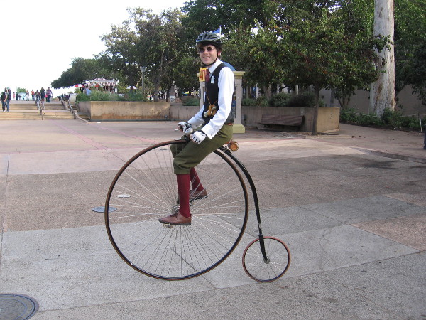 Brandon Carpenter smiles from atop his cool, historic penny-farthing.