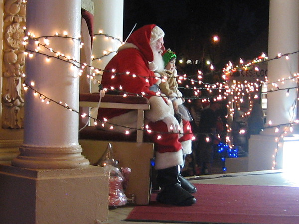 In the Spreckels Organ Pavilion, Santa Claus brings a child joy.