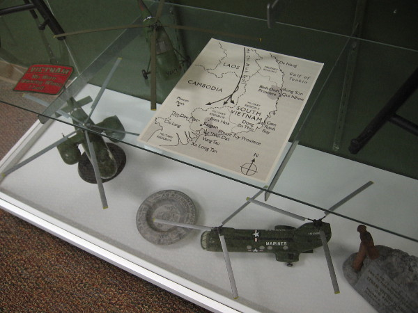 One exhibit includes a map of Laos, Cambodia, and North and South Vietnam during the war.